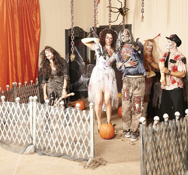a gory and ghastly zombie scene is perfect for a halloween party use zombie costumes fake blood tons of chains and spooky fence to get the look - Halloween Theme Party Ideas